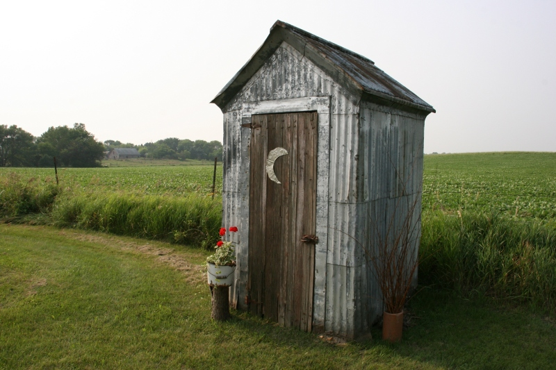Brian and Vicki recently added an outhouse (used for storage) to their property. This reminds me of the first 11 years of my life, living in a house without a bathroom and using a two-holer outhouse.