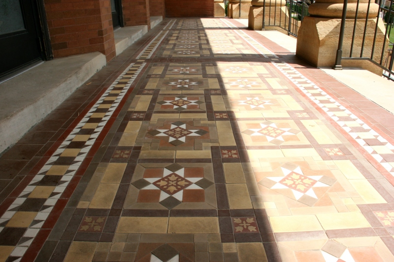 In sunlight (right) and in shade, the exterior tile floor under the columned entry is lovely.