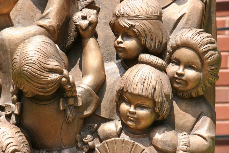 Children of many ethnicities are part of the Mary statue.