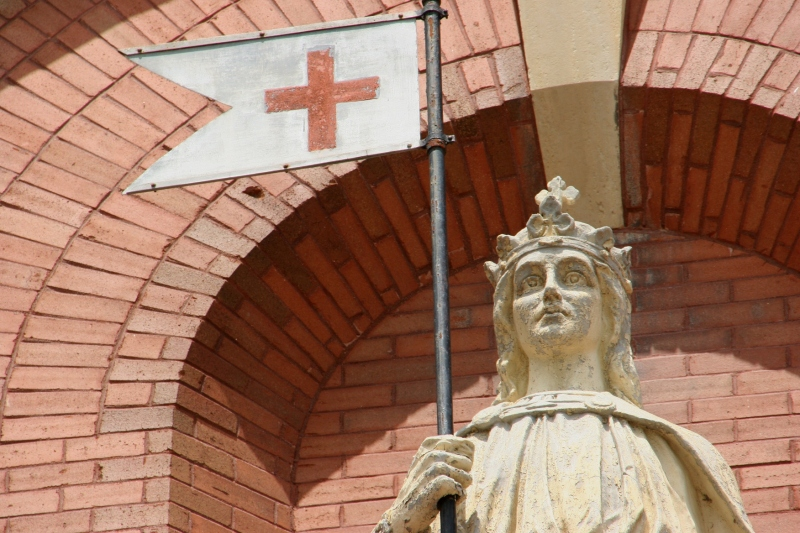 A close-up of the St. Wenceslaus statue above the main church entry.