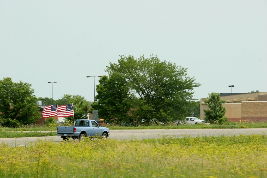 American flags a wavin', this truck takes the northbound entrance ramp onto Interstate 35 off Minnesota State Highway 60 Friday afternoon.