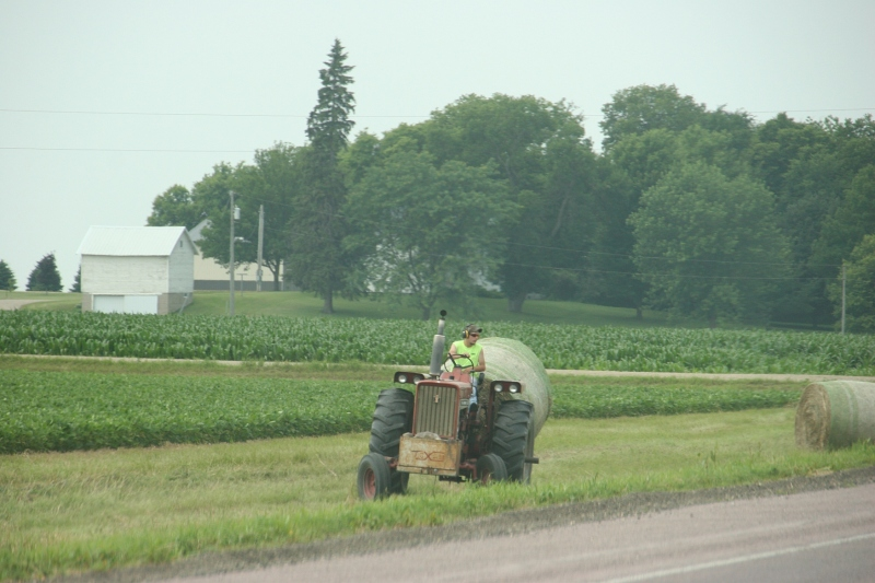 Baling the road ditch between Mankato and New Ulm.