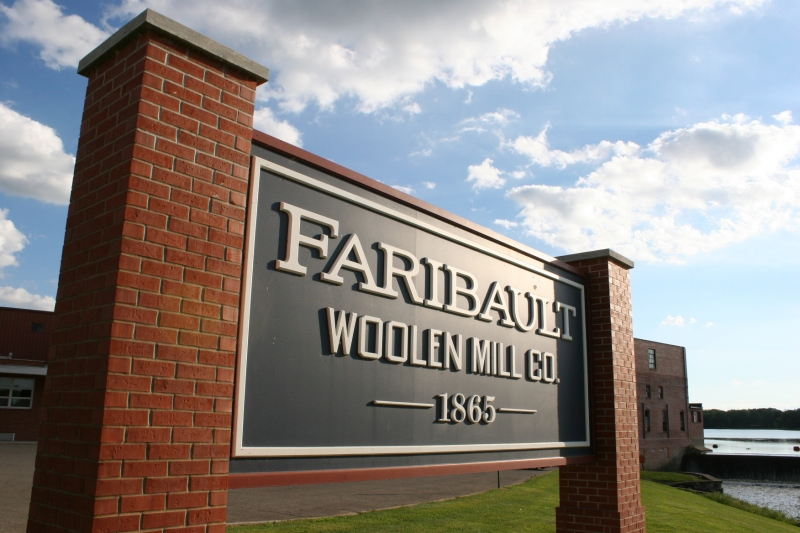 This sign marks The Faribault Woolen Mill, which sits along the banks of the Cannon River in Faribault, Minnesota.