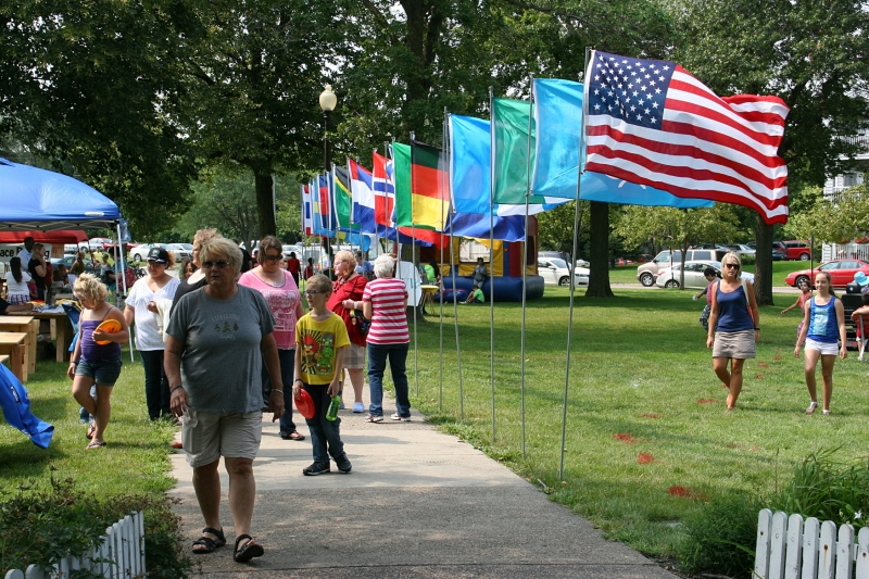 Flags representing Faribault residents lined the sidewalk.