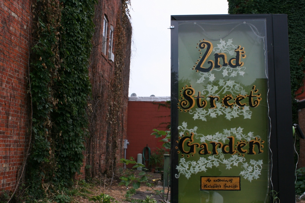 A lovely sign defines the garden.