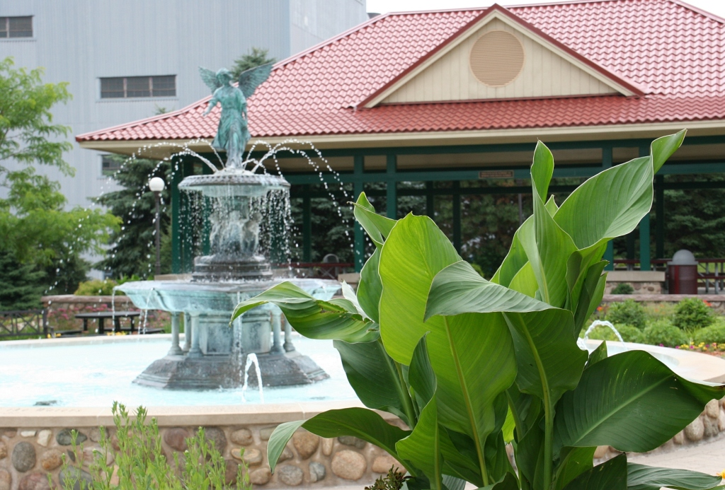The Angel Fountain centers the park which features an abundance of plants and flowers.