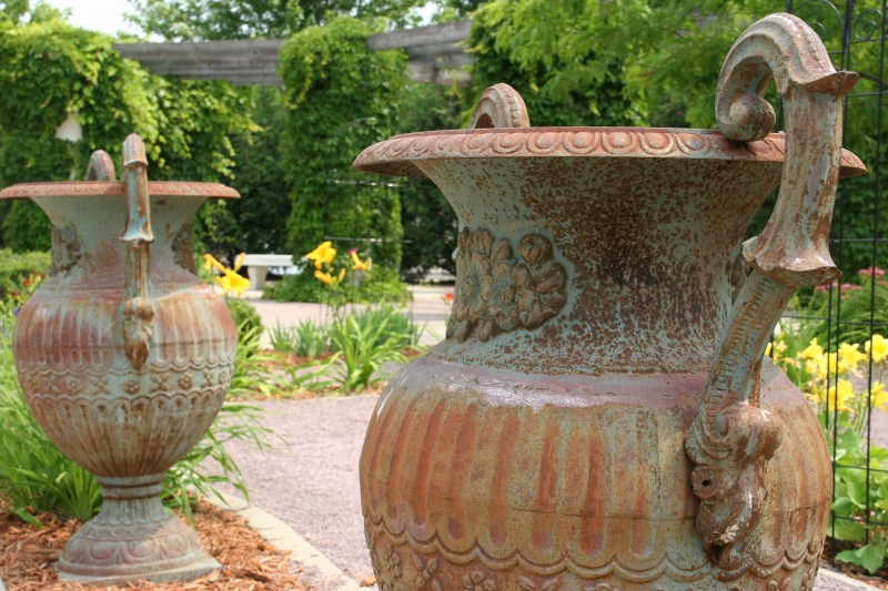 I love these rustic urns, which are so large and heavy it would take several people to move them.