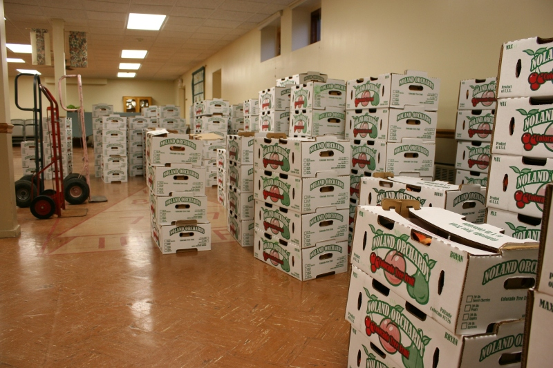 Boxes of peaches await pick-up in the basement of First English Lutheran Church.