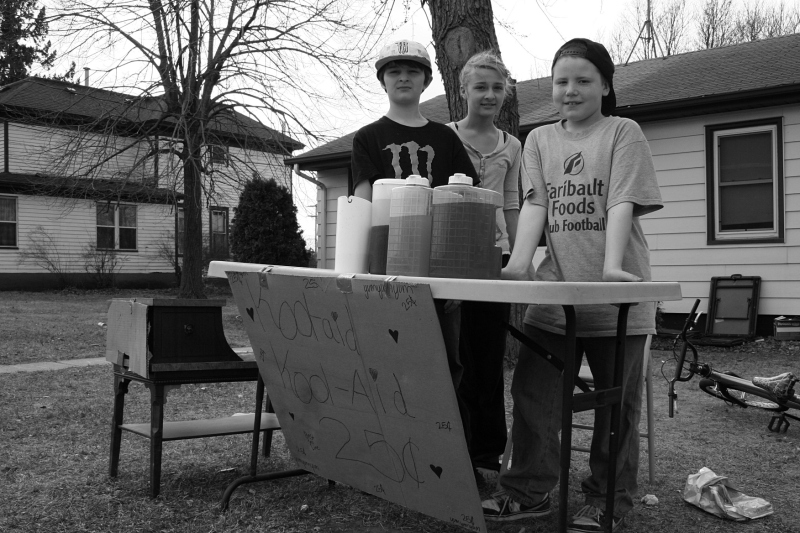 Quinlan, left; his sister, Jazmyn; and friend William sell lemonade on March 17, 2012. The boys were the primary sellers. Jazmyn assisted occasionally and popped in for the photo.