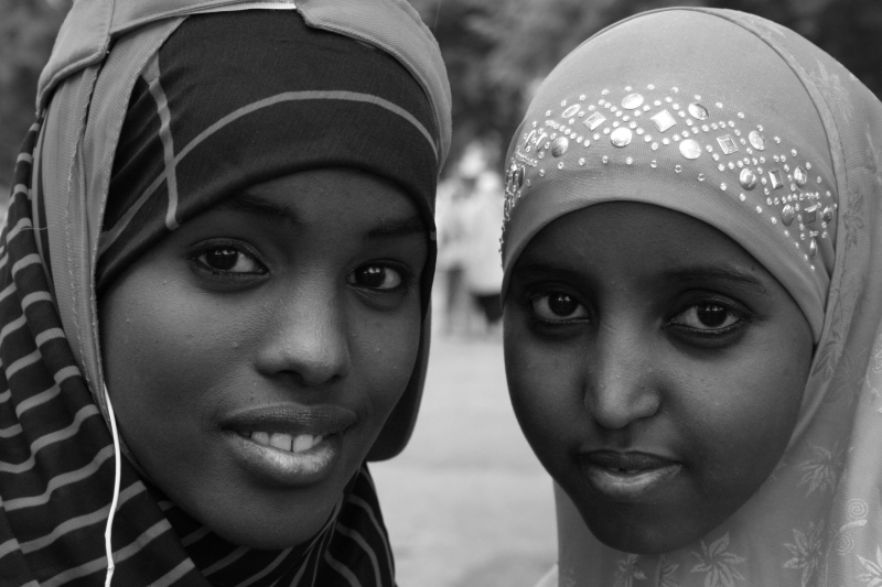 Friends and then Faribault High School seniors Shukri Aden, left, and Khadra Muhumed photographed at the International Festival Faribault 2012.
