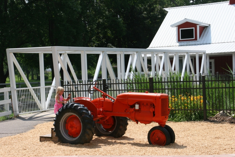 Kids love the tractors, this one located next to the bridge spanning the pond stocked with fish and dotted with water lilies.