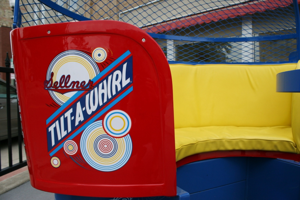 Signage and seating inside the restored amusement car.