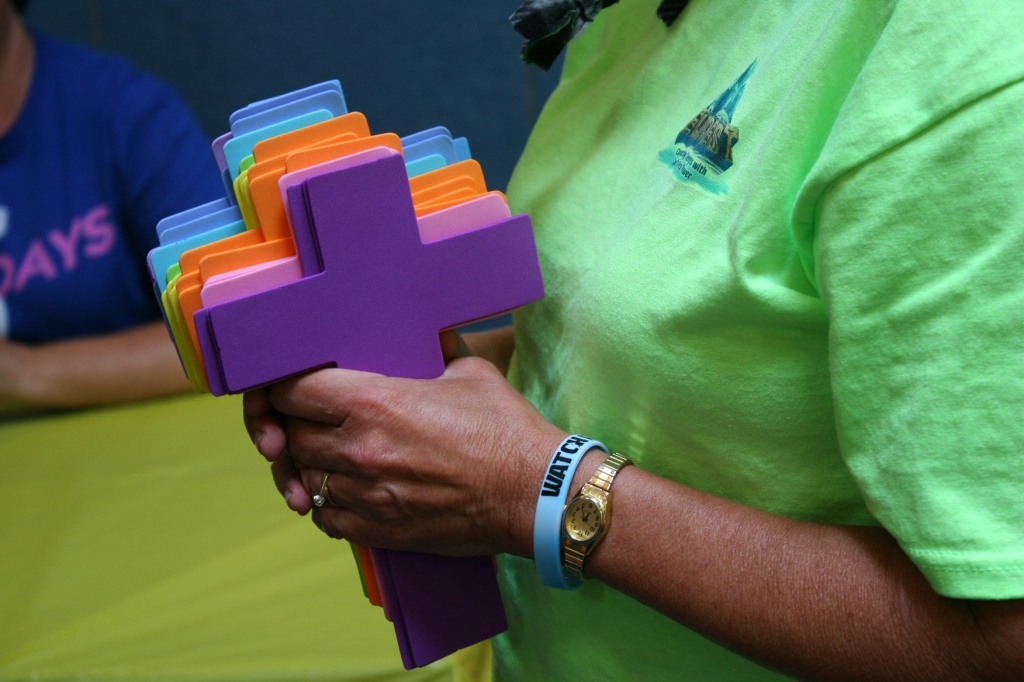 One of my favorite close-up VBS photos shows the VBS leader clutching crosses to be used in a craft project.