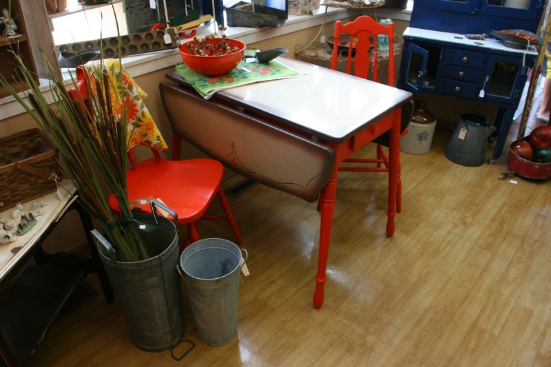 A unique table that punches color combined with orange chairs.