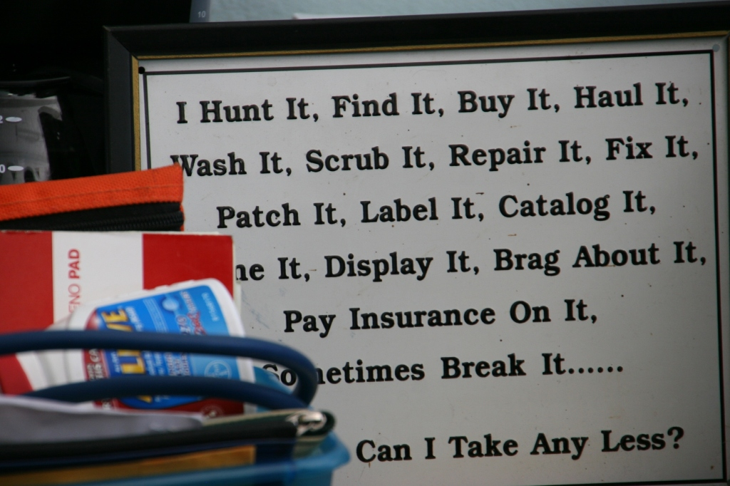 A sign posted in Woody's shop.