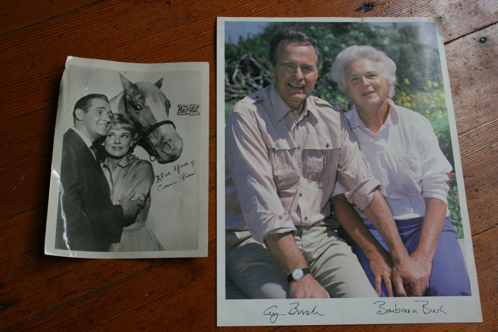 Woody pulled these autographed photos from his bulletin board. That's former President and Mrs. Bush and, to the left, Mr. Ed. Both were found tucked inside manuals he purchased.