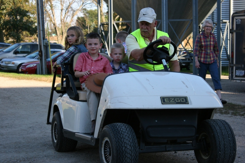 The kids all wanted rides on the golf cart.