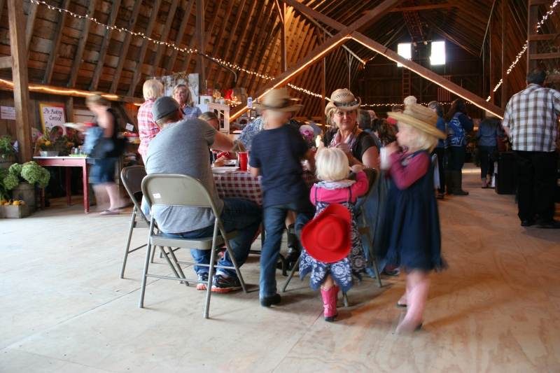 Grandparents build memories with grandchildren at the barn dance.