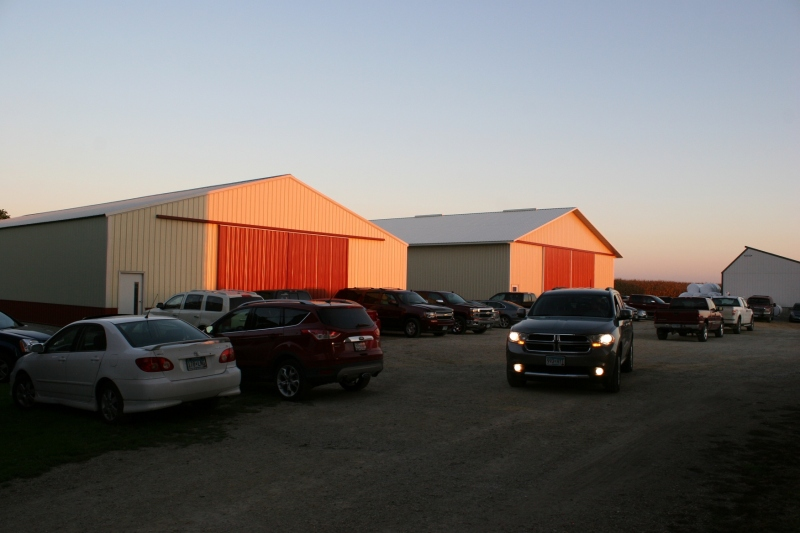 The sun spotlights machine sheds. Vehicles parked in every nook and cranny on the farm.