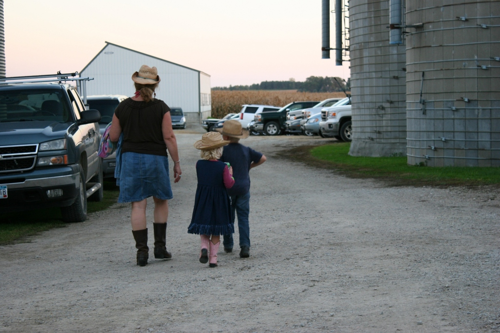 A grandma and her grandkids dressed in western attire for the barn dance.