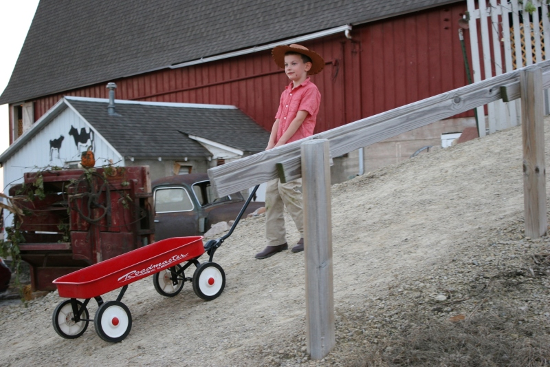 As this boy pulled a wagon up the incline toward the hayloft, I wondered if he would climb aboard for a wild ride down. Instead, he released the wagon. I would have rode down, gripping the handle.