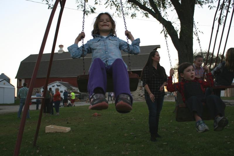 A vintage swingset proved a popular spot.