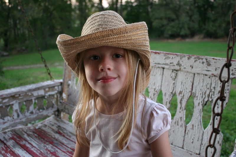 This girl's cowgirl hat reminded me of the straw hats I wore while playing make-believe as a child.