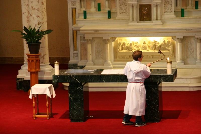 An altar boy prepares for Mass.