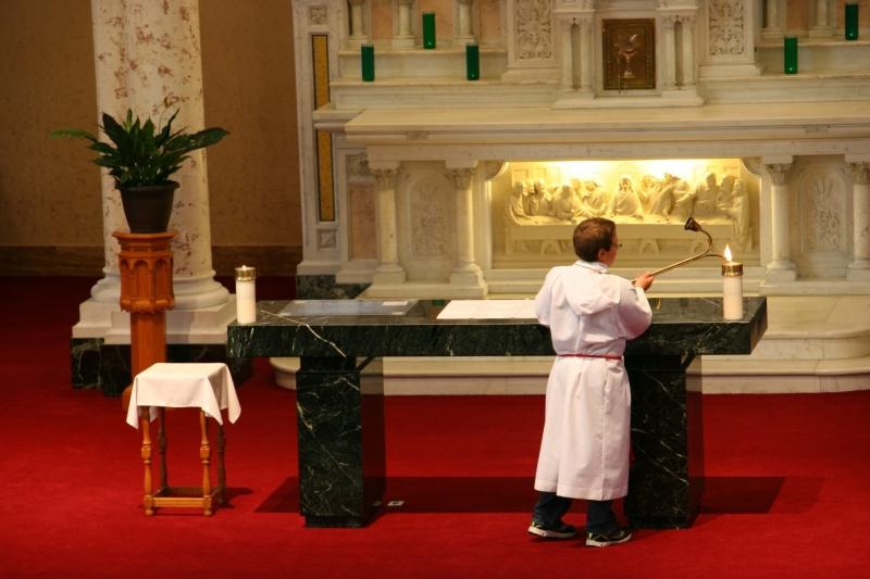 An altar boy prepares for Mass.