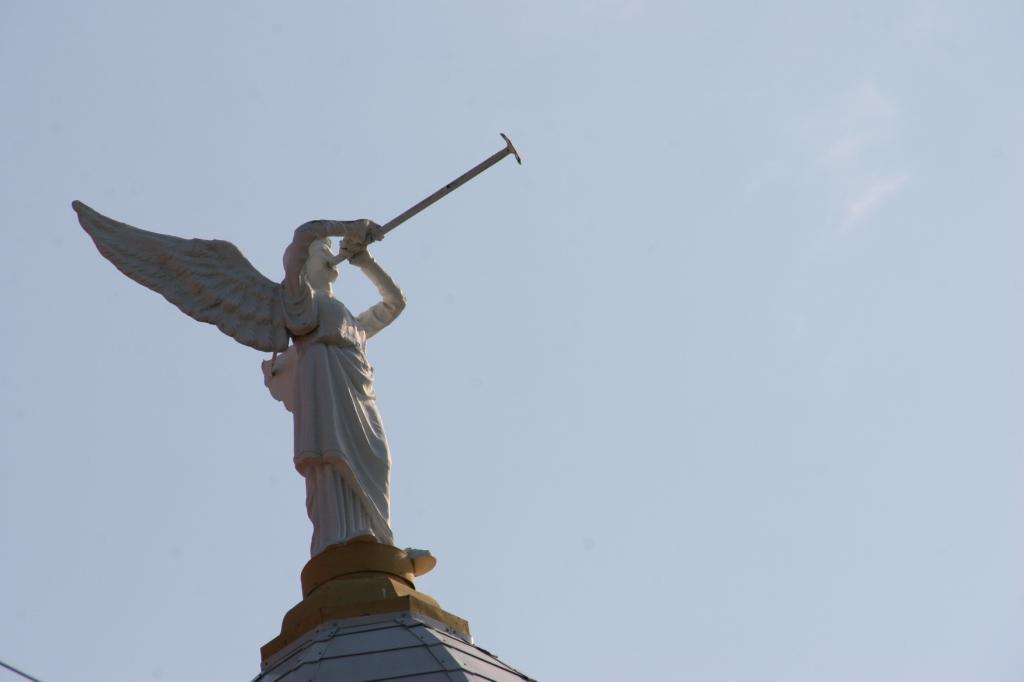 Angel art atop a tower.