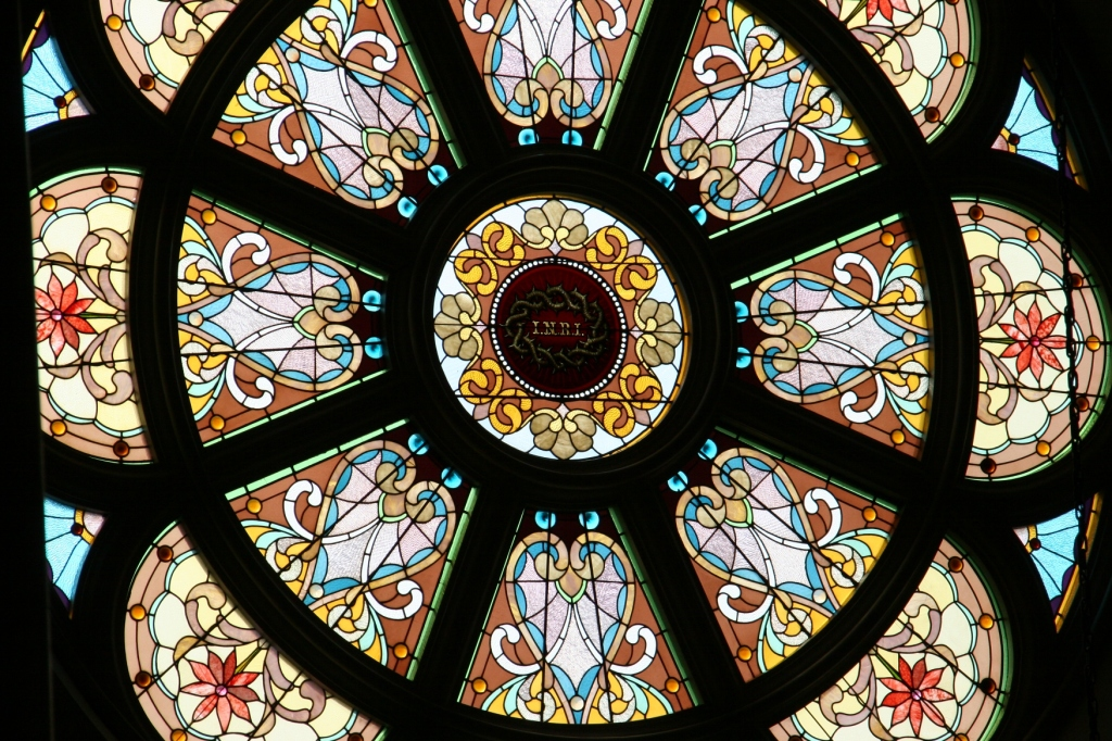 The basilica features stunning stained glass windows.