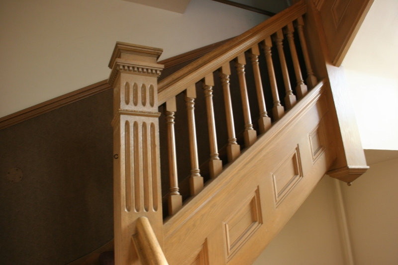 The stairway to the balcony features incredible craftsmanship.