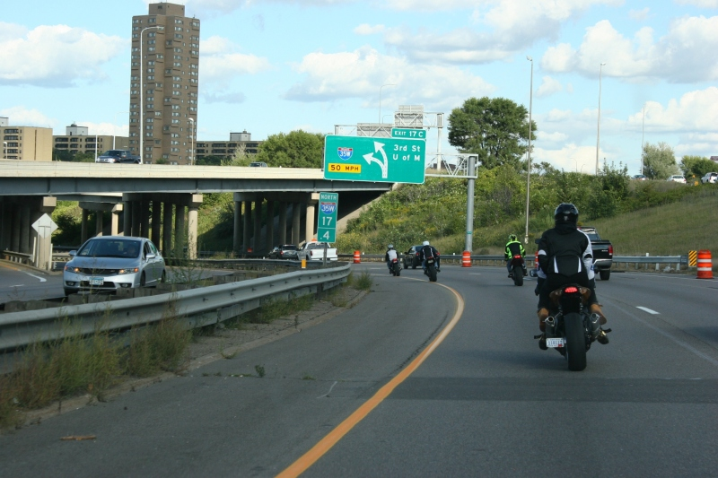 Bikers on I-35 rounding curve near downtown Minneapolis