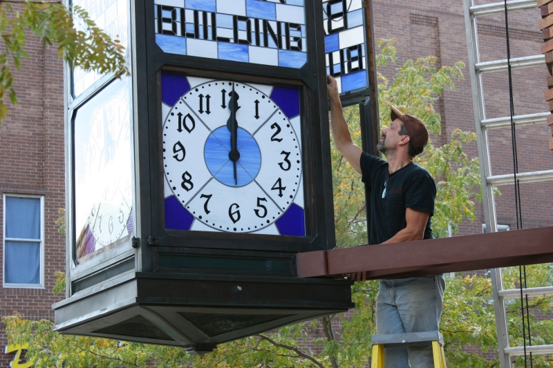 Another view of Mike Elwood working on the clock.