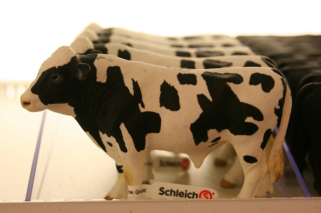 Rows and rows of Schleich animals fill shelves.