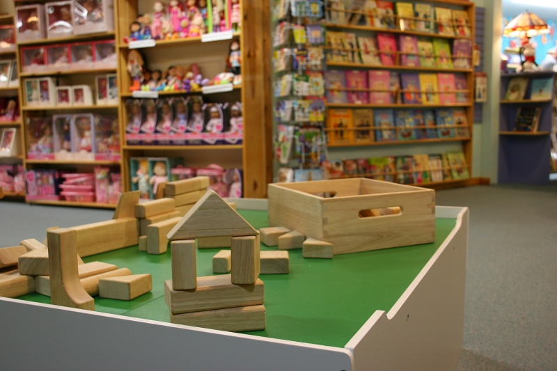 Toy samples are set up for kids to play with within the toy store.
