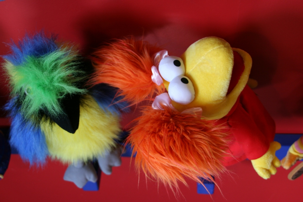 Playful puppets pop color into a section of the multi-room toy store.