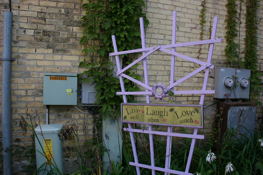 A lavender trellis pops colorful art into the garden.