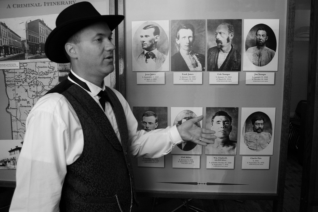 Christian Hakala talks about gang members involved in the Northfield bank raid, pictured to his left: Frank and Jesse James; Cole, Bob and Jim Younger; Clell Miller; William Chadwell; and Charlie Pitts.