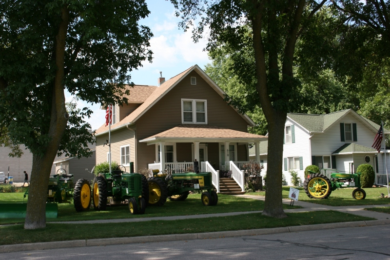 Next, I was distracted by all these John Deere tractors parked in a front yard. I don't know why.