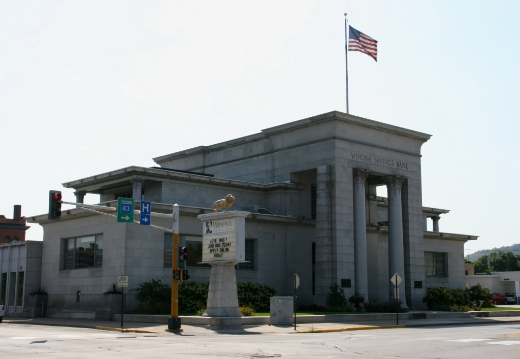 The exterior front of the Winona National Bank, originally Winona Savings Bank, presents a visual of strength and stability in design and materials.