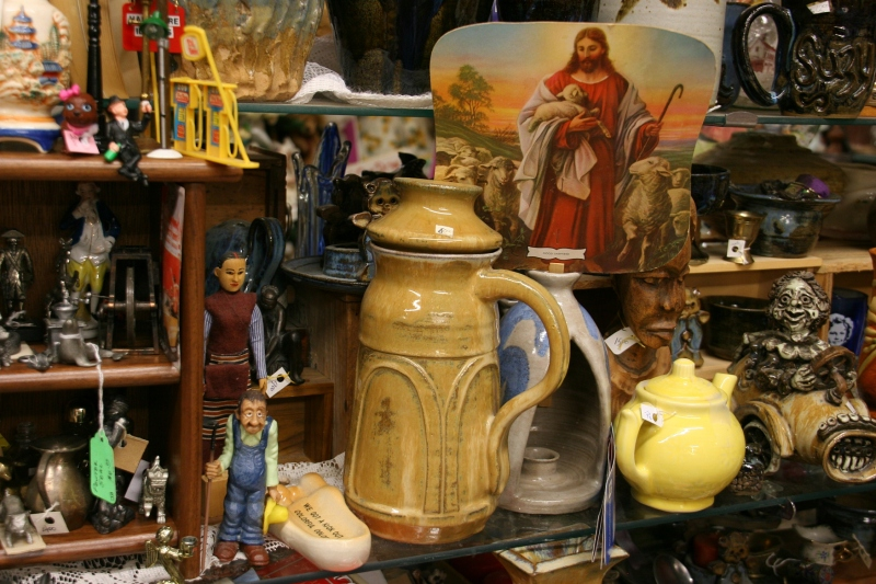 An example of Adams pottery, center, sits among other merchandise.