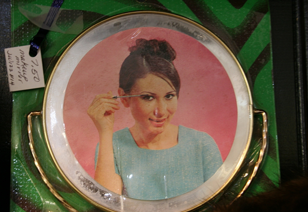 Although I didn't want this vintage 1960s make-up mirror, I never-the-less was drawn to it.