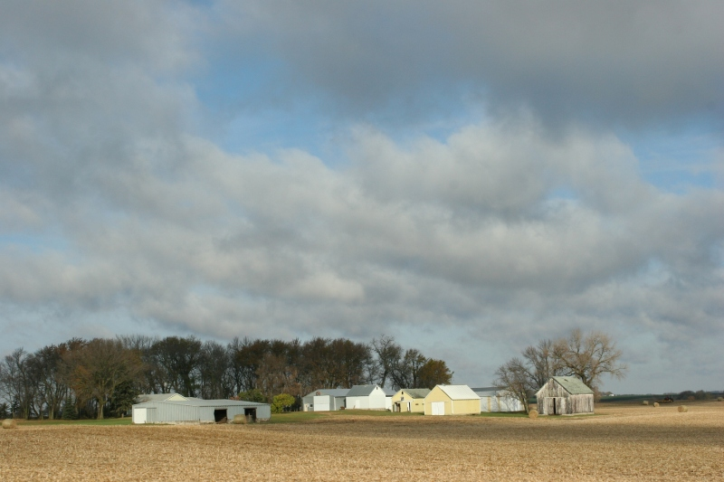 Clouds break apart over a farm along U.S. Highway 14 in southwestern Minnesota.
