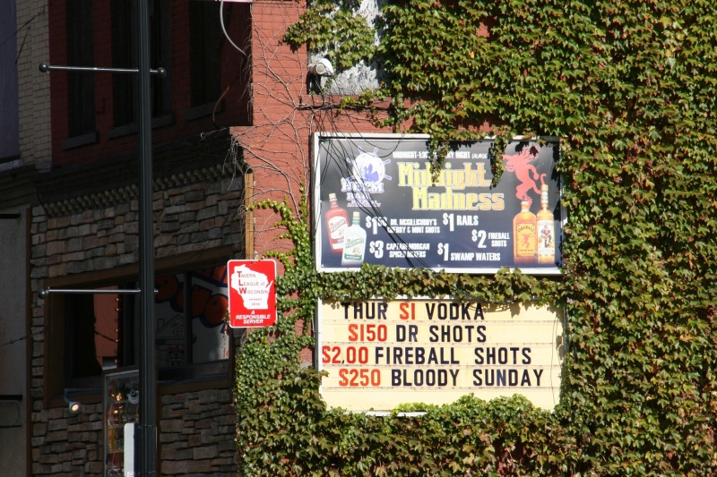 Advertised drink specials alongside a sign that