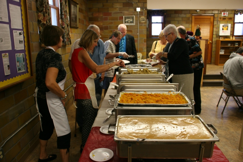 Delicious home-cooked food fills roasters at Trinity's annual fall harvest dinner on Sunday.