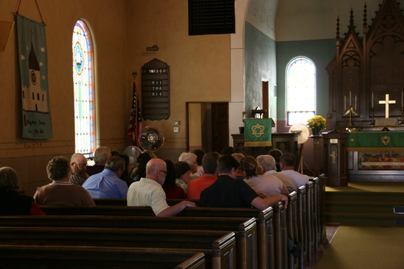 Diners file into the sanctuary through a side door and wait in pews until dining space opens in the basement.