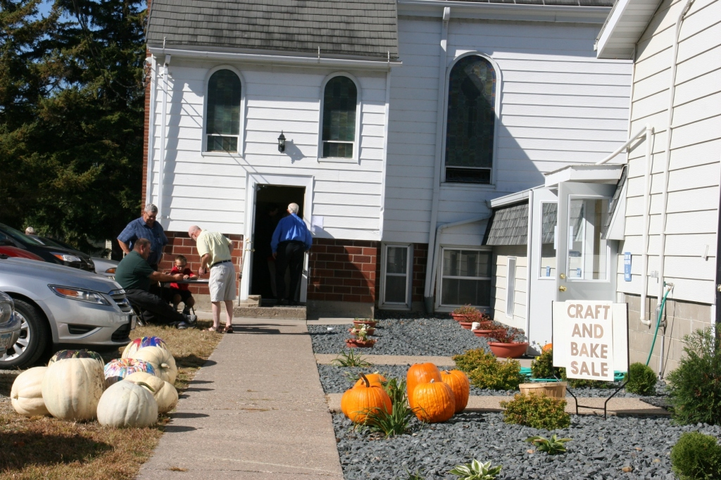 Volunteers sell tickets outside the church.