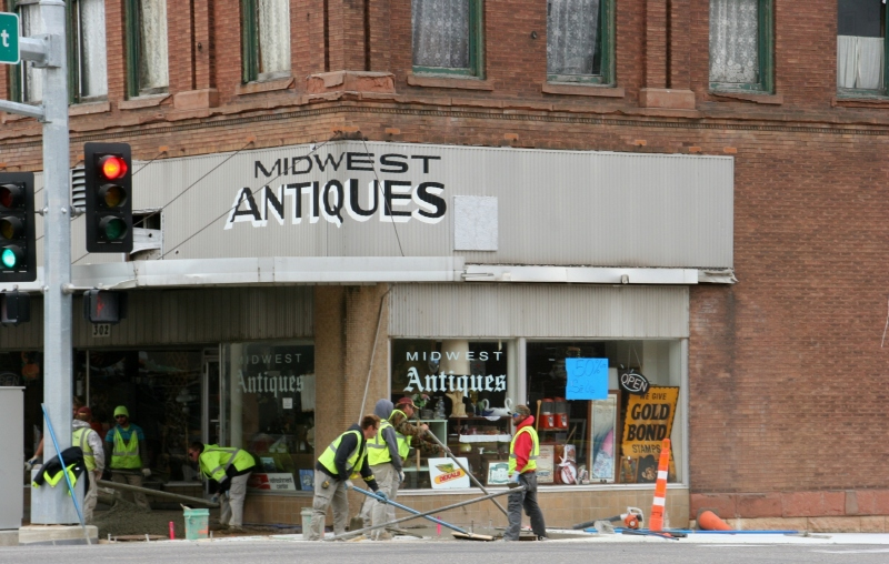 Even though a sign flashed open in this antique shop, we could not figure out a way to gain entry to the business around newly-poured sidewalks.
