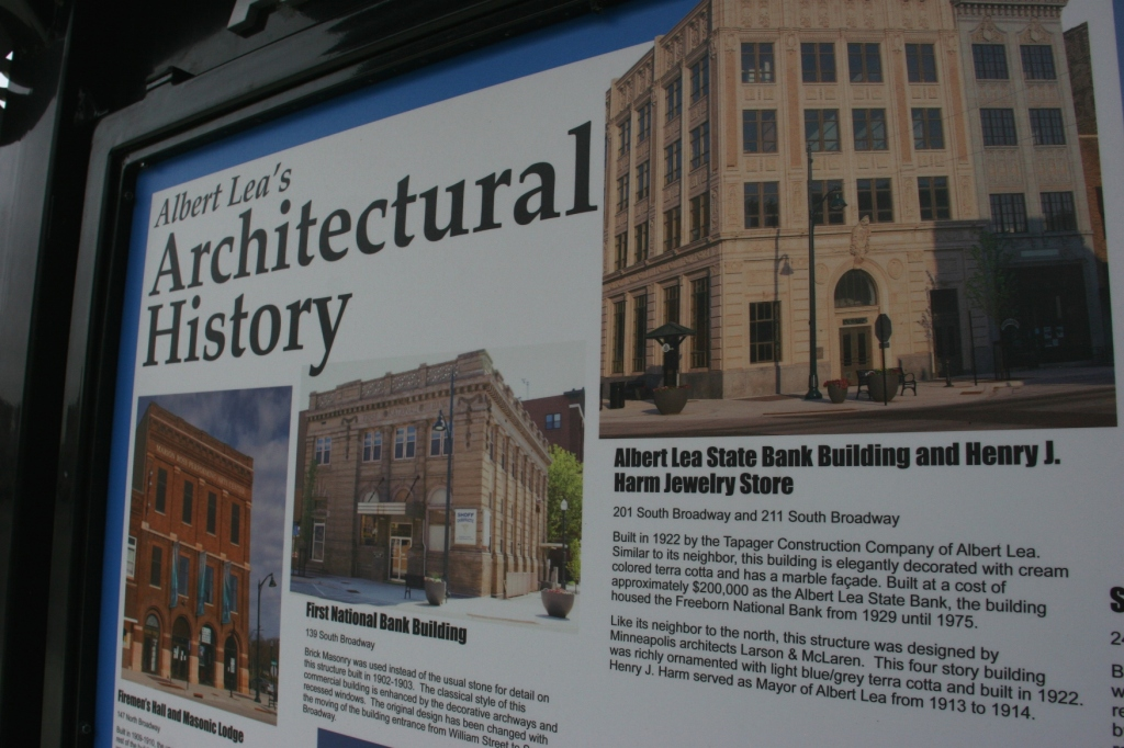 An informational kiosk in the downtown shares info about historic buildings.